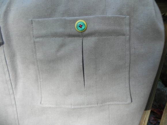 Inverted pleat pocket with stacked buttons on School Days Jacket